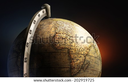 old history map desktop metal globe on abstract background - stock photo