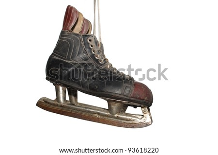 old hockey skates on white background - stock photo