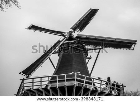Old Holland windmill. Black-white photo. - stock photo