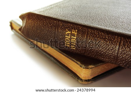Old Holy Bible, resting on another vintage book.  Soft focus, shallow depth of field.