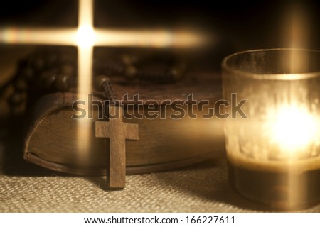 Old Holy Bible, Rosary Beads and Candles. - stock photo