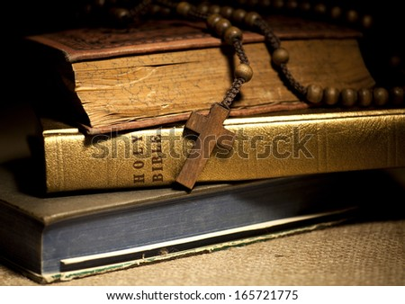 Old Holy Bibles and Wooden Rosary Beads. - stock photo