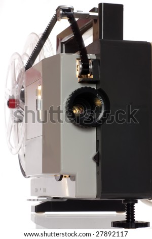 Old home cinema projector for 8 mm films - stock photo