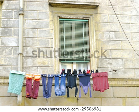 Old home with clothesline in Rome, Italy - stock photo