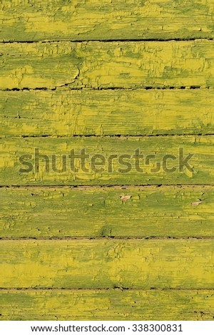 Old horizontal planks painted green yellow copyspace - stock photo