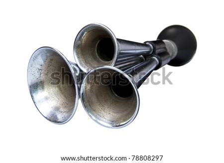 Old horn triple bell isolated on a white background.