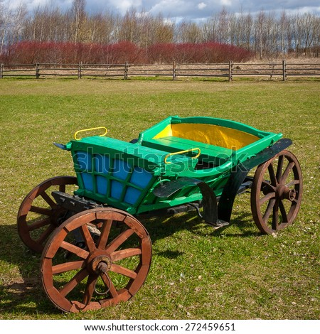 Old horse wagon standing on a rural farm - stock photo