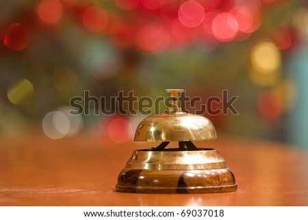 old hotel bell on a wood stand at Christmas - stock photo