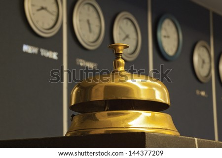 old hotel bell with watch in background - stock photo