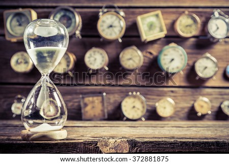 Old hourglass as the old way of timing - stock photo