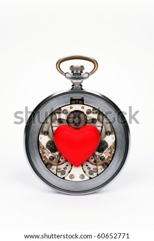 Old hours with the double mechanism on a white background