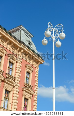 old house and streetlamp over blue sky - stock photo