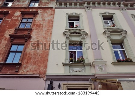 old house and windows with wooden frame and flowers vases