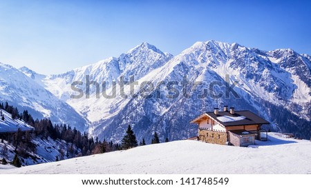 old house at the european alps in winter - stock photo