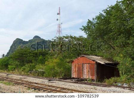 Old house beside railway - stock photo