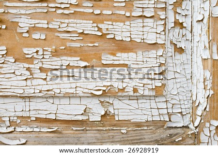 old house door with shrimped white paint - stock photo