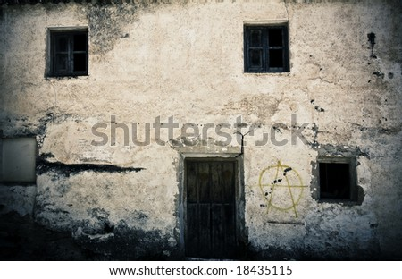 Old house facade, abandoned and grafted. - stock photo