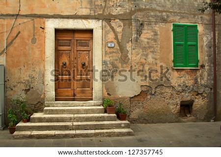 Old house facade in Tuscany, Italy - stock photo
