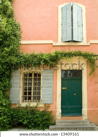 Old house facade with shutters, Provence, France - stock photo