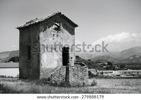Old house in a wheat field. Provence, France. Black and white photo - stock photo