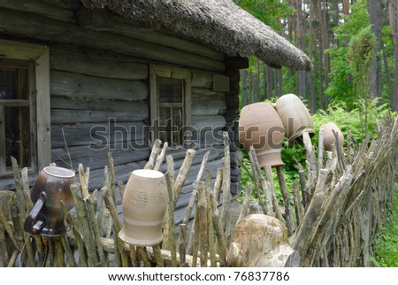 Old house in the one of the oldest open-air museums in Europe - Ethnographic Open Air Museum in Riga, Latvia - stock photo