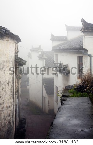 old house in thick fog - stock photo