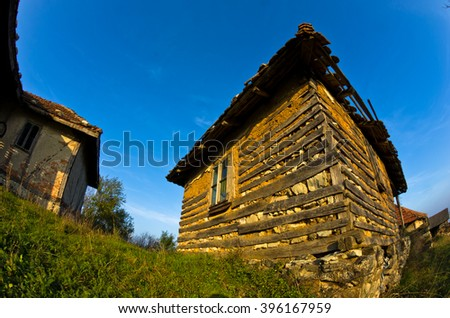 Old house near Danube river at sunset of autumn sunny day, east Serbia - stock photo