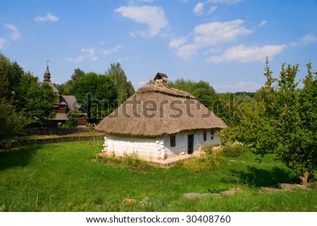 Old house of Ukrainian folk architecture - stock photo