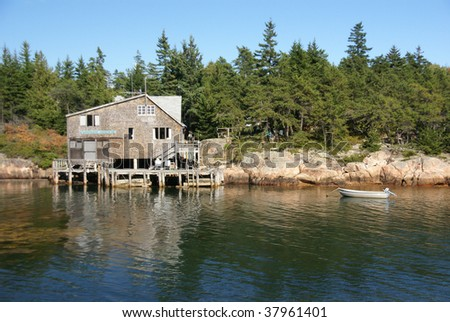 Old house on harbor edge,  Gouldsboro, Maine, New England