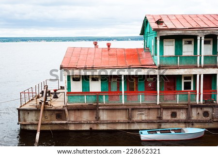 Old House on water - stock photo