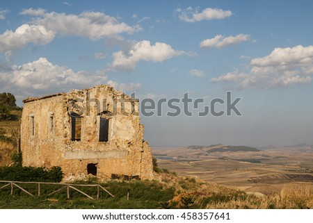 Old house standing over the ruins of the ancient city of Morgantina, Sicily island, Italy - stock photo