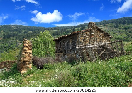 old house under the blue sky - stock photo