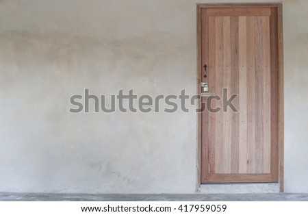 old house wall with wooden door - stock photo