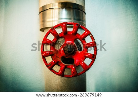 Old house water pipe valve close up. Water management concept. - stock photo