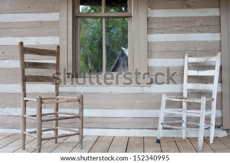 Old house with a couple of old chairs - stock photo