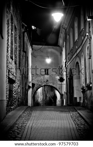 old house with an arch pavement in light of lantern, Vilnius