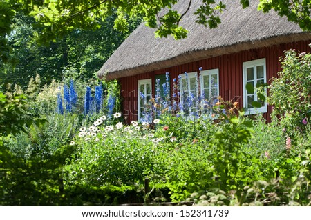 Old house with reed roof in Skansen park in Stockholm, Sweden - stock photo