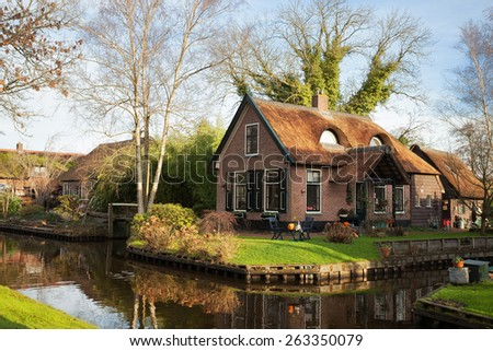 Old house with  thatched roof  in Giethoorn, Netherlands. - stock photo