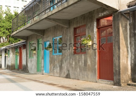 Old house with vivid window and door in Taipei, Taiwan, Asia. - stock photo