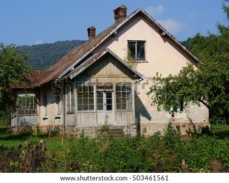 old house with wooden sun-parlour