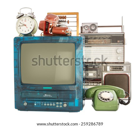 Old household items: TV, VCR, radio, camera, alarm, phone, recorder, abacus.   Old household items isolated on white background.  - stock photo
