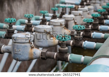Old household water pipe valve,Side view. - stock photo