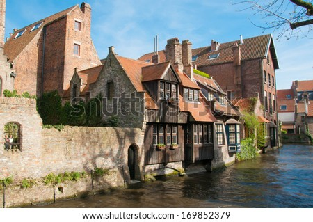 Old houses along the canals of Bruges, Belgium