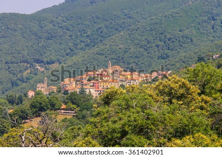 Old houses and bell towers on the hill on Elba Island, Marciana, Italy - stock photo