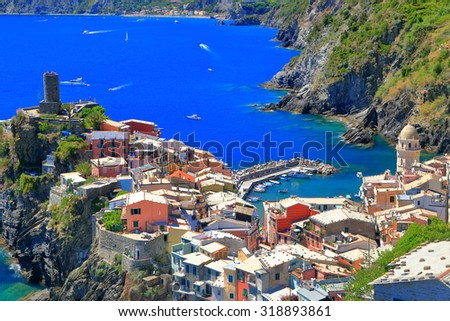 Old houses and medieval fortress around the harbor of Vernazza, Cinque Terre, Italy