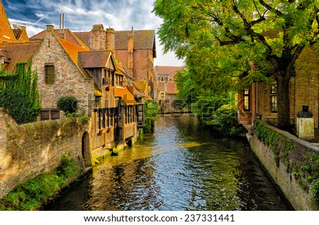 Old houses at the canals in Bruges, belgium. - stock photo