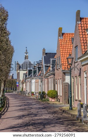 Old houses at the central street in IJlst, Holland - stock photo
