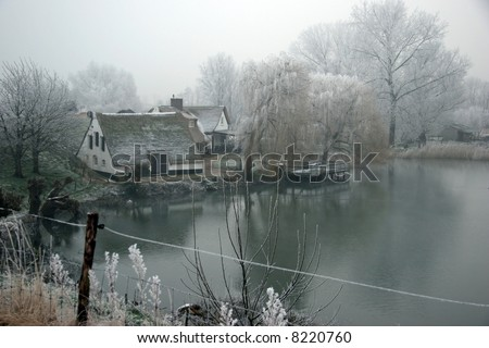 Old houses in Holland along the dike - stock photo