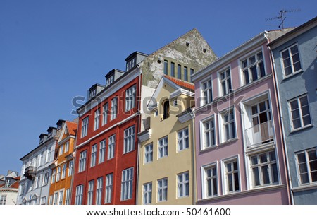 Old houses in Nyhavn which is a colourful 17th century waterfront, canal and popular entertainment district in Copenhagen