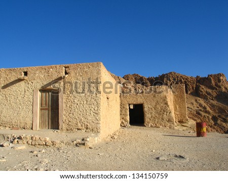 Old houses in Sahara desert in Tunisia, Africa - stock photo